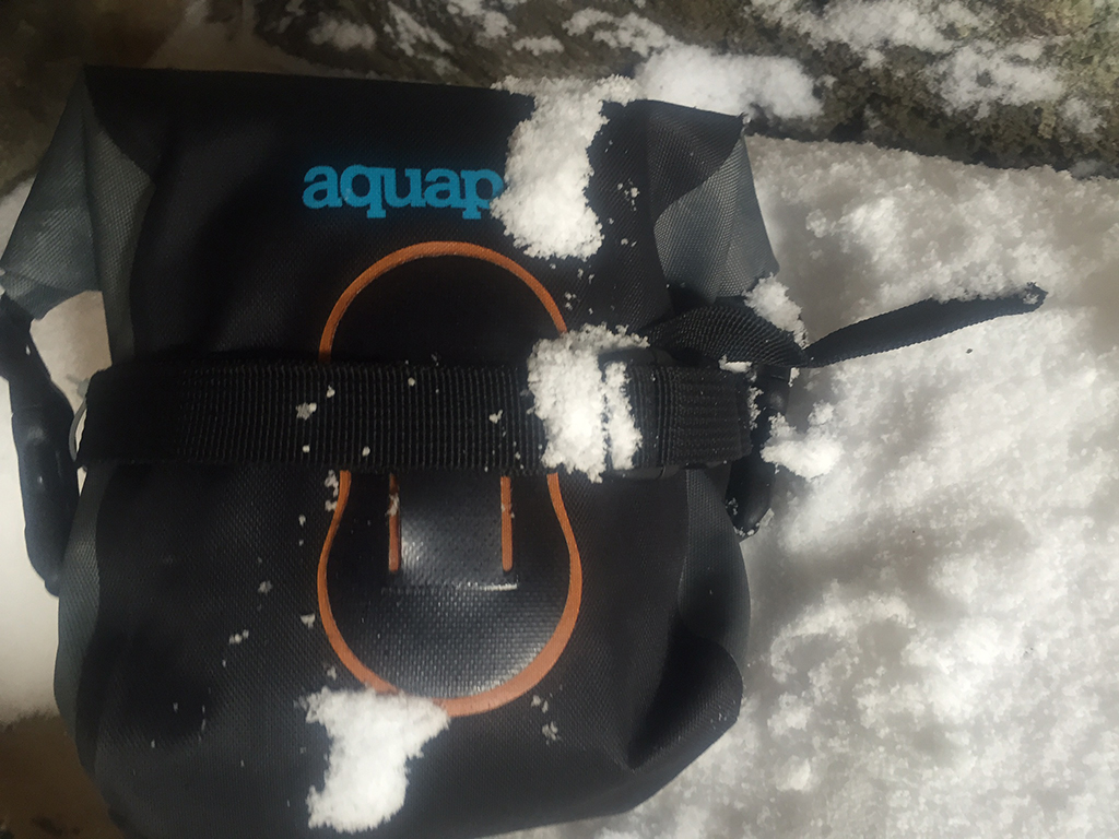 stormproof Aquapac camera case in snow