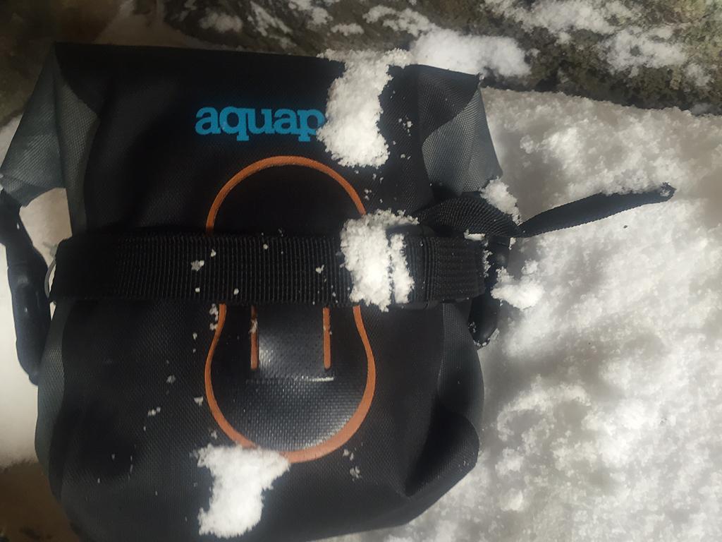 stormproof Aquapac camera case in snow